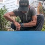 Ced Vandenschrik setting up new surfboard